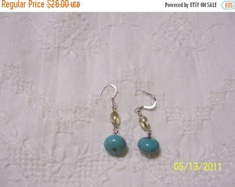 20 OFF EVERYTHING Turquoise Color Magnesite and crystal dangle earrings.