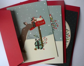 Set of 3 Christmas postcards featuring a Christmas bunny in the snow with red envelopes