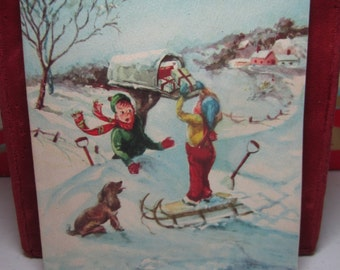 1940's-50's unused Pollyanna christmas card 2 boys in snow 1 stands on sled to open mailbox filed with toys dog watches Artist signed Pitman