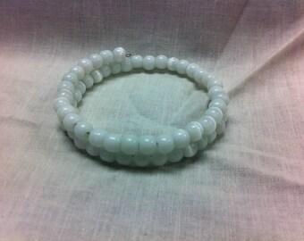Purple or white cats eye beaded bracelet