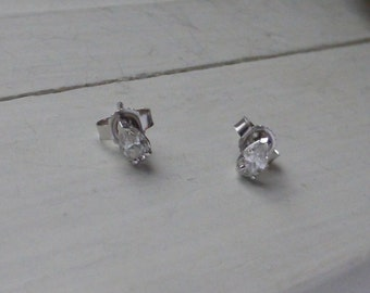 Unique 14k Pear cut Diamond solitaire earrings. Approx.