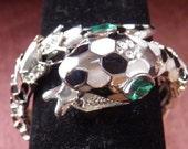 Snake bracelet, KJL and Very Dramatic.