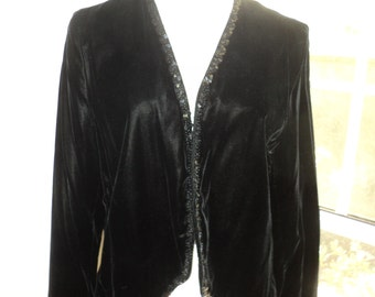 Vintage SIZE 16 Black Velvet Bolero Jacket with wonderful hand sewn black sequin trim on the collar and hem in Very Good Condition