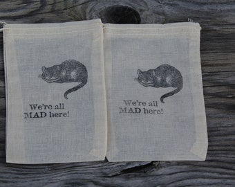 Set of 10 Hand stamped We're All Mad Here Alice In Wonderland Party Favor Muslin Bags 100% organic made in america