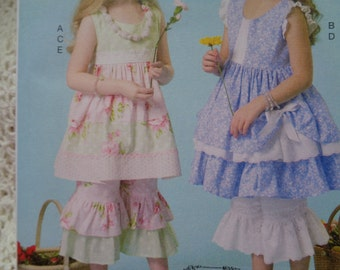 McCall's Sewing Pattern 7110 Children's Dress, Pants and Necklace in Size 6-8