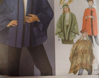 Simplicity pattern 5309 Misses ponchos and capes in sizes S, M, L in 2 lengths with hat patterns.