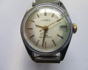 "Vintage ladie's watch ""Timex Quartz""  silver tone metal band snap closure  used watch"