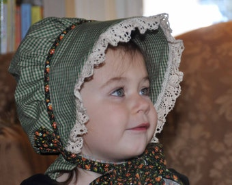 Prairie Baby Bonnet Green Homespun with Crocheted Lace and contrasting calico piping and ties