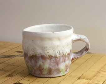 Green and milky white ceramic cup