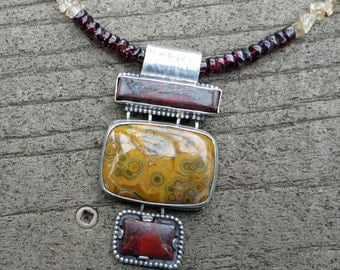 Ocean Jasper and Red Jaspelite Sterling Silver pendant on a citrene and garnet necklace