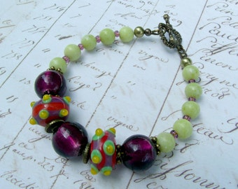 FREE US SHIPPING-Fun with green and purple:Lampwork,glass foil,gemstones and antique brass beaded bracelet