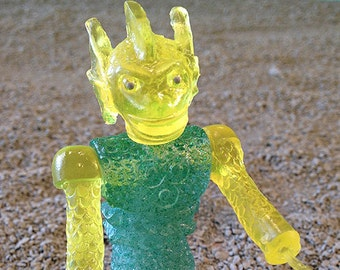 SEA-BORG MUTATION  Wave 2 Plastic Resin Figure - yellow/green glitter