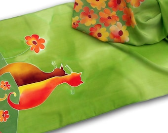 Hand painted silk scarf with orange cats & flowers in green.