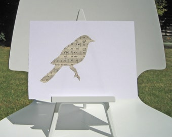 A SONG BIRD - hand made paper cut from Vintage Sheet music