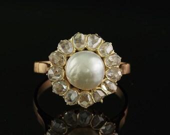 A Victorian rose cut diamond and natural Basra pearl ring