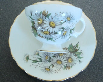 White Teacup and Saucer with Daisies