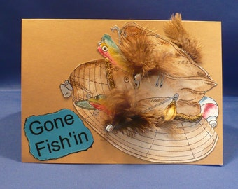 Gone Fish'in ... Hand Painted Fishing Hat on  A7 Light  Brown Card Stock ... Embellished with Feathers and  Cording.