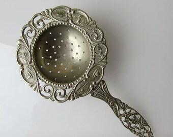 Vintage Tea strainer with handle, very ornate openwork pattern