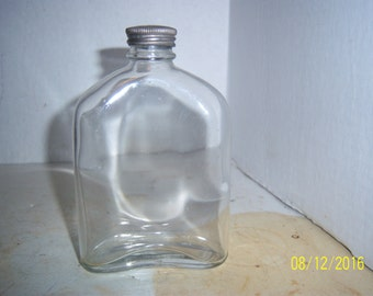 1910's MJ 5 inch Liquor Whiskey clear pocket flask bottle