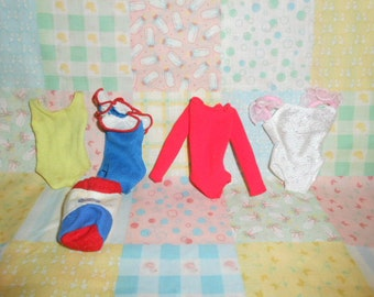 Four Barbie Suits and A Matching Bag
