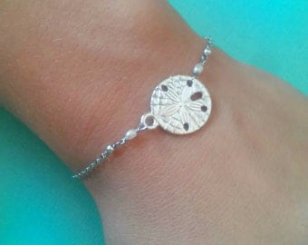 Silver sand dollar bracelet with tiny freshwater pearls