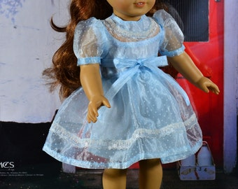 American Girl style 4 piece party dress including dress, slip, hair bow and shoes done in light blue organdy with white polka dots.