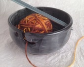 One of a kind ceramic yarn bowl with a matte black glaze brushed with white glaze