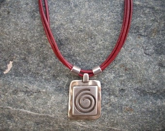 Triple Strand Dark Rich Red Leather Necklace with Hammered Silver Square Black Swirl Pendant and Silver Slider Beads