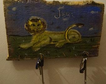 """Key rack """"Lion-Guardian"""" on old board"""