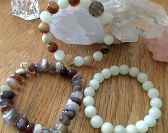 Three crystal braclets Jade Smokey Quartz Agate