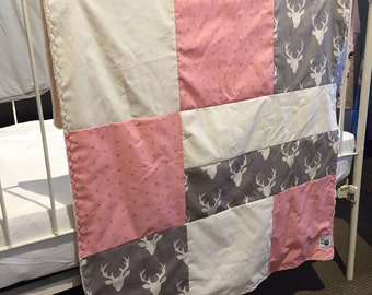 Baby blanket ,deer heads, gold X on pink and white circles on ivory