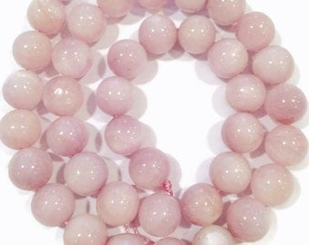 Kunzite smooth rounds.  Select a size: 8.5-8.75mm, 10mm