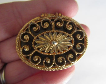 vintage MAX FACTOR HYPNOTIQUE Gold Tone  Oval  case with solid perfume