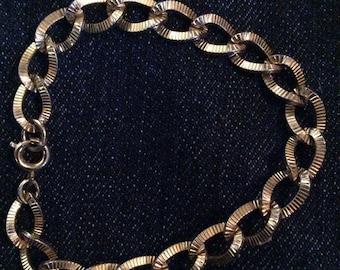 Gold tone bracelet 6 in