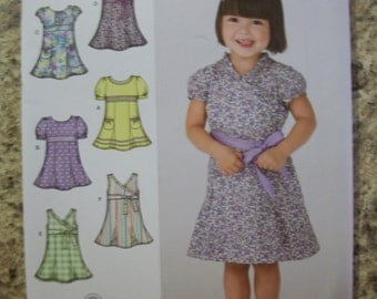 Simplicity 3512 Toddlers (Size A 1/2,1,2,3,4) dresses