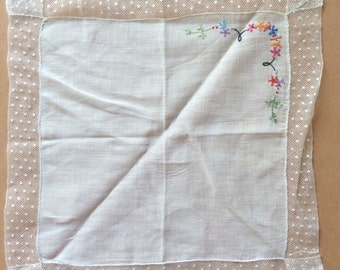 Dainty little handkerchief with dotted net border and embroidery
