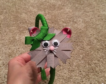 Cat ribbon sculpture bow