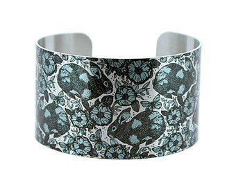 Rabbit jewellery cuff bracelet, brushed silver wide metal animal bangle with blue bunnies. C227S