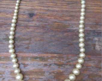 vintage single strand of pearls