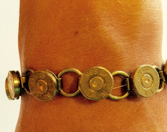 Bronze bullet bracelet with 12 bullets in the caliber of your choice.