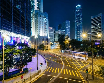 Long exposure of an intersection and modern skyscrapers at night, at Central, Hong Kong. | Photo Print, Stretched Canvas, or Metal Print.