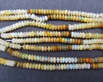 "Beads: 16.5"" gemstone strand - natural Ethiopian opal - 5x2mm rondelles - browns, creams, whites"
