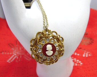 Gold Tone Cameo Pendant Necklace With Open Border And Rhinestones