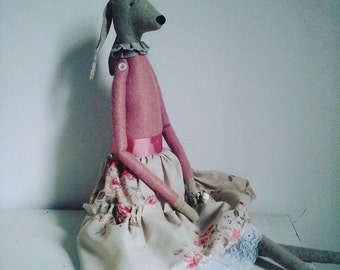 Tall skinny hare decorative soft toy.