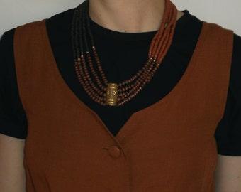 Beaded africa inspired necklace, golden details