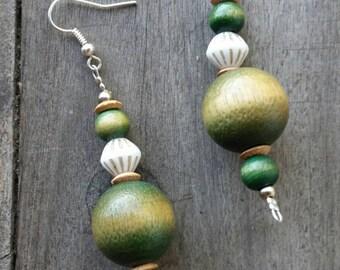 Handmade green wood and vintage white porcelain bead earrings on silvertone shepherd hooks