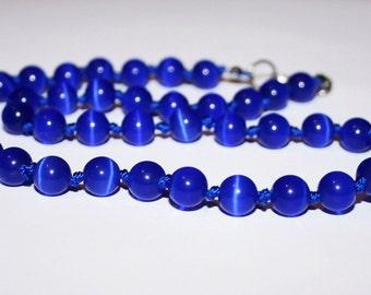 Beads cat's eye 8 mm. Strand of beads blue cat's eye.
