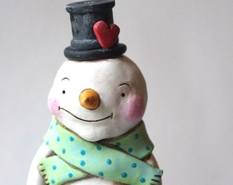 Snowman with Candy Cane and Heart on Hat Folk art sculpture from polymer clay