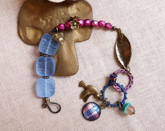 Czech glass boho chic bracelet Raspberry and blue colors Brass leaf and bird Cabochon Patinaed rings