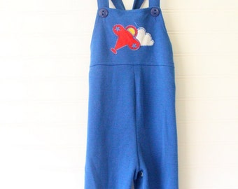 Vintage baby boy overalls. Blue overalls with a plane in the clouds on the chest. Carters sz 18 mo